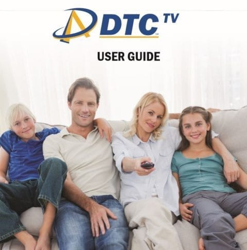 Family sits on a couch watching TV - Click to for PDF user guide.